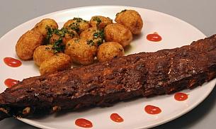 Coaste de porc la cuptor cu cartofi aromati